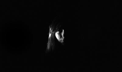 Using artifial lighting in a darkroom to experiment with portrait photography. Model - Miriam.